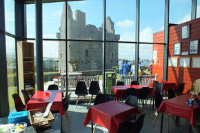 Photo of our cafe area with the view of the castle through the window